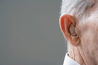 Close up of senior Hispanic manÕs hearing aid
