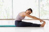 Hispanic woman practicing yoga (thumbnail)