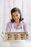 Hispanic woman baking cookies