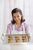 Hispanic woman baking cookies