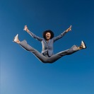 African businesswoman jumping in mid_air