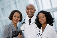 African businesswoman posing with doctors