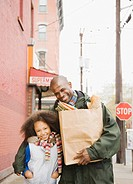 African father and daughter with groceries