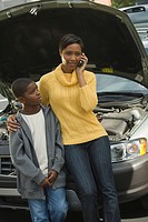 African mother and son having car trouble