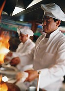 Hispanic chef in commercial kitchen