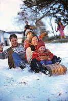 Family on sled in snow
