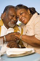 Senior African couple hugging