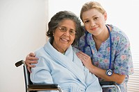 Female nurse with senior Hispanic woman in wheelchair