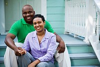 Portrait of African couple on porch steps