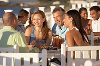Two couples eating at outdoor restaurant