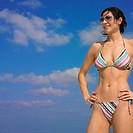 Woman wearing bikini and sunglasses