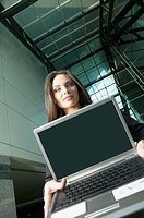 Italian businesswoman holding laptop