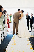 Bride kissing father in aisle