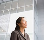 Pacific Islander businesswoman looking up