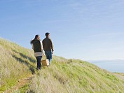 Hispanic couple walking on dunes