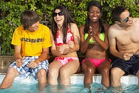 Multi_ethnic group of friends enjoying pool party