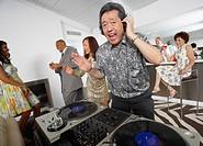 Asian DJ performing at party