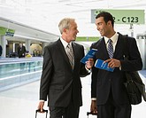 Businessmen holding tickets in airport