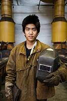 Japanese welder posing with helmet