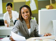 African businesswoman working at desk