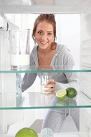 woman looking into an empty cooler