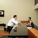 Asian couple talking in kitchen