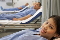 Asian female medical professional in hospital bed