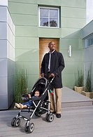 African American father pushing baby in stroller