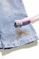 Dirty Jeans and toothbrush