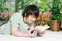 Young man reading (thumbnail)