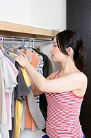 Young woman selecting the clothes