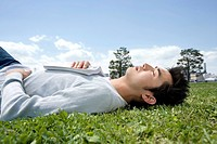 Young man sleeping on the grass