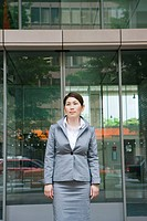 Business woman in front of the building