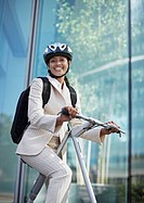 Businesswoman on Folding Bike