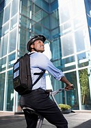 Businessman with Solar Panelled Backpack on Folding Bike