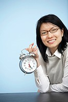 Mid_Adult Businesswoman Holding Alarm Clock