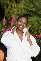 Portrait of woman in bathrobe outdoors