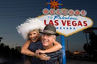 Middle_aged couple in front of Welcome to Las Vegas sign portrait