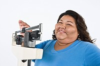 Woman using weight scales