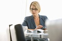 Business woman working in conference room (thumbnail)