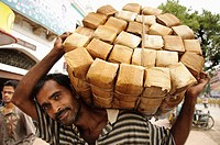 A man carrying a load into the market  Mysore, India