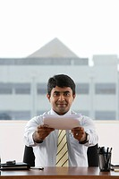 business man handing over a stack of paper