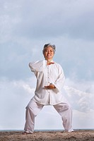 Older woman doing martial arts.