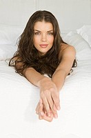 Woman beauty sitting on bed