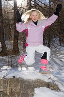 Girl Jumping wearing ski outfit