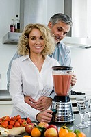 Man and woman preparing healthy drink