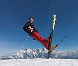 Man balancing on skis and skiing poles