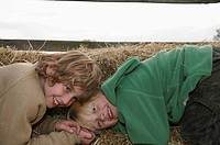 Two boys on hay bales