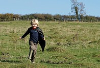 Super Hero boy in countryside