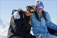 Female snowboarders smiling